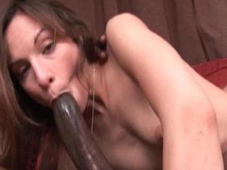 Hottie takes a large black dick down her face hole